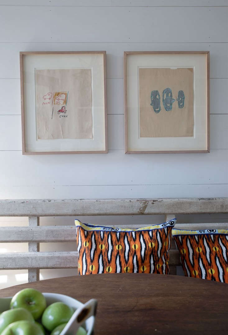 works by a friend hang over the dining table. 20