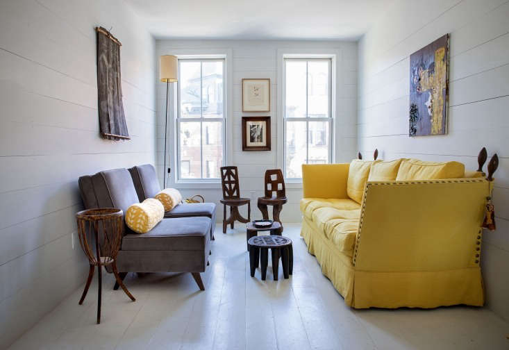 the interior narrows from 600 square feet downstairs to 400 square feet on the  15