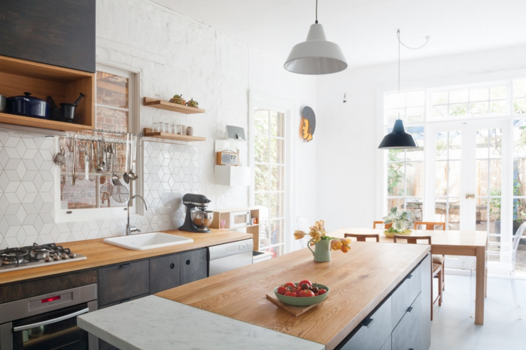 Remodeling 101 All About Butcher Block Countertops In this kitchen by Melbourne interior architecture firm Hearth Studio, a kitchen island is segmented into American oak and Carrara marble for a work surface.