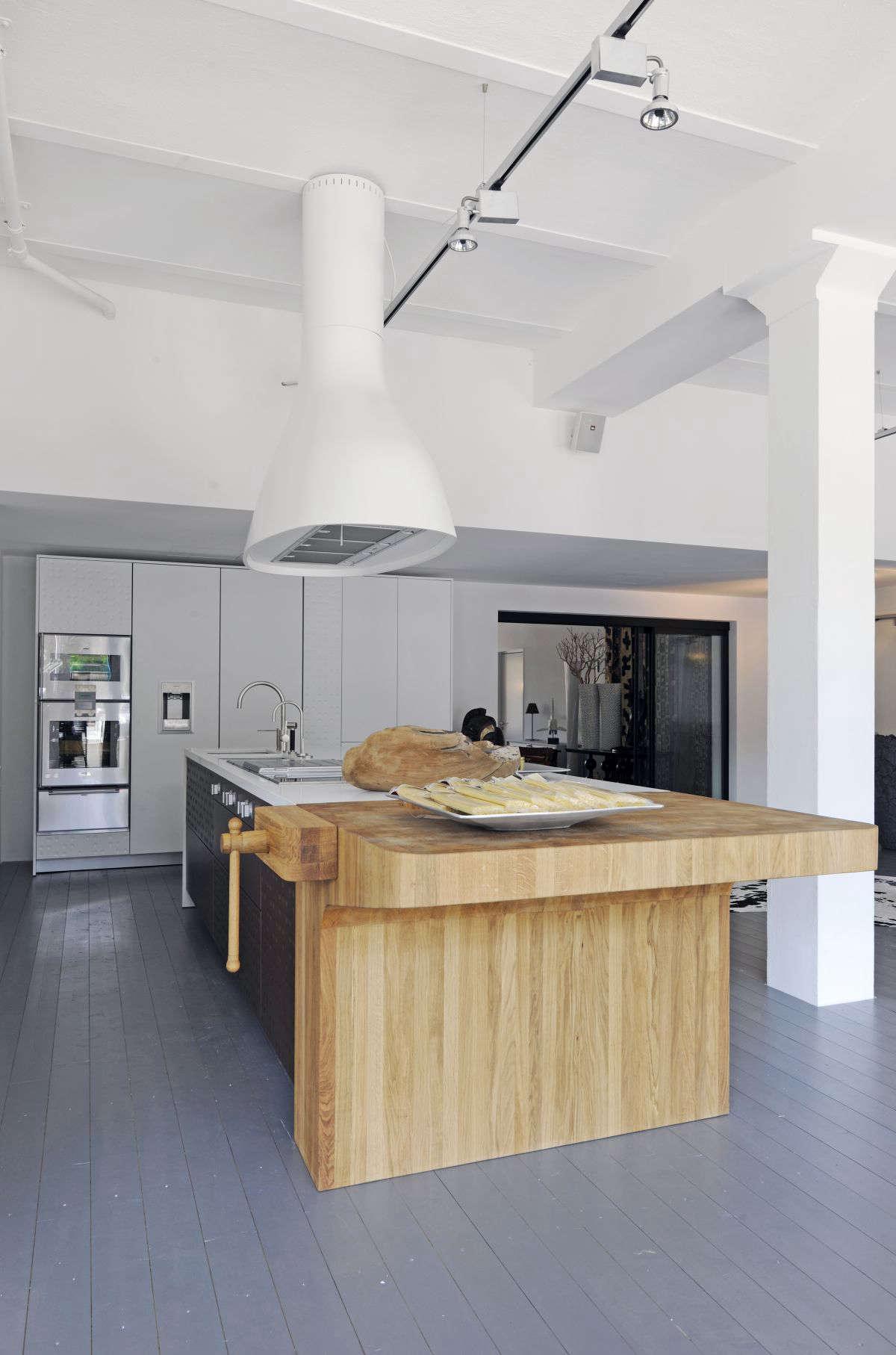 Italian kitchen designers Schiffini use end-grain butcher block at the end of a kitchen island.