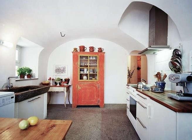 chesa wazza kitchen orange door | remodelista 11