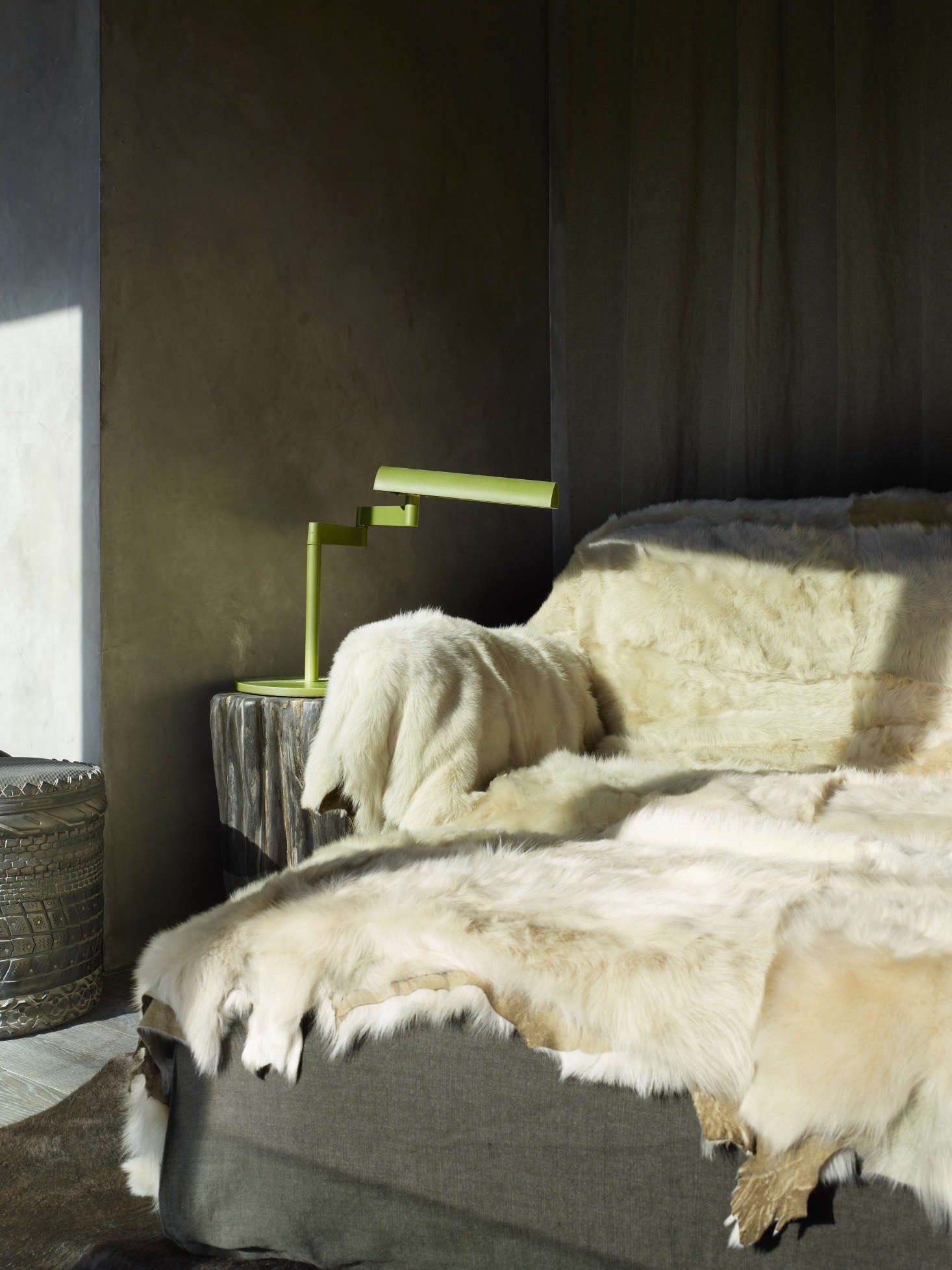A reading chair draped in fur.