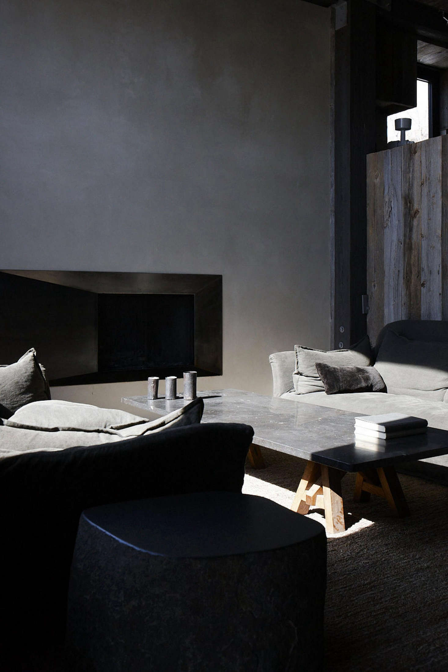 Stone gray linen compliments stone side tables and a slab coffee table.