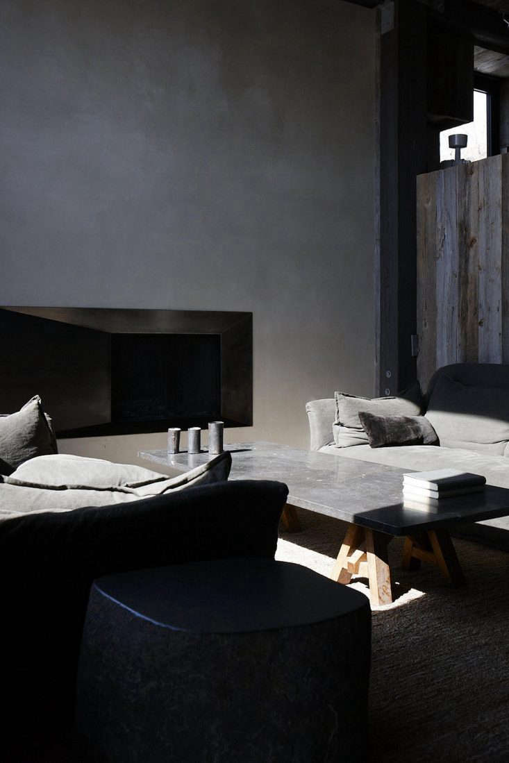 stone gray linen compliments stone side tables and a slab coffee table. 11