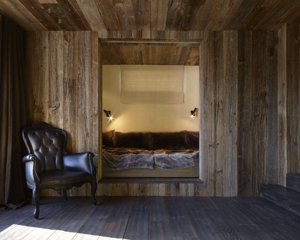 A bed carved into a wall.