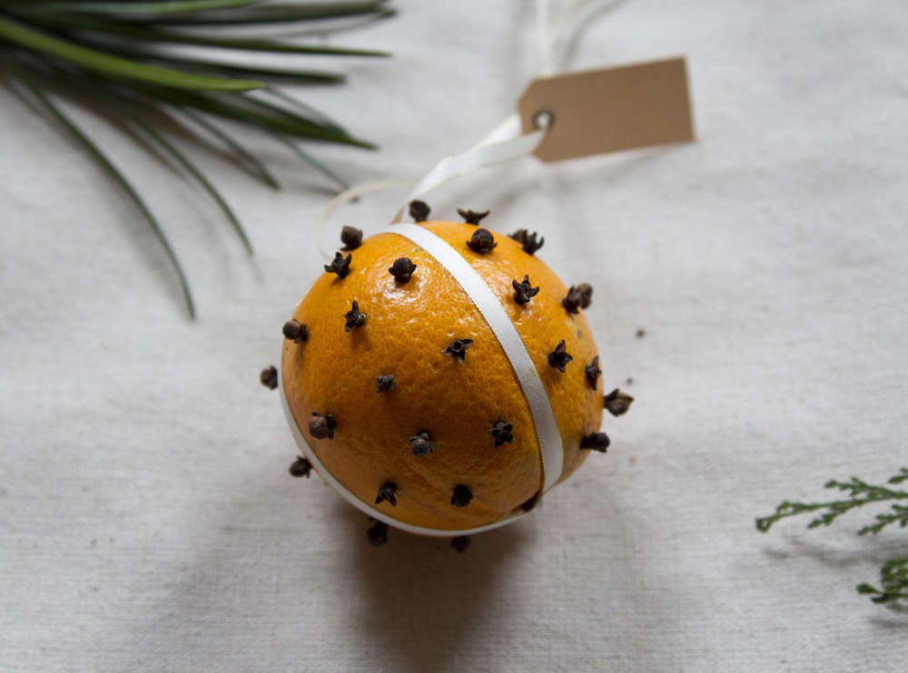 One of our favorite all-time DIY ornaments is also one of the simplest: a traditional pomander made of an orange studded with whole cloves and hung from a length of ribbon. You could even tuck a small pouch of cloves into one of the days of your advent calendar (see idea no. 5) for a festive (and good-smelling) activity.