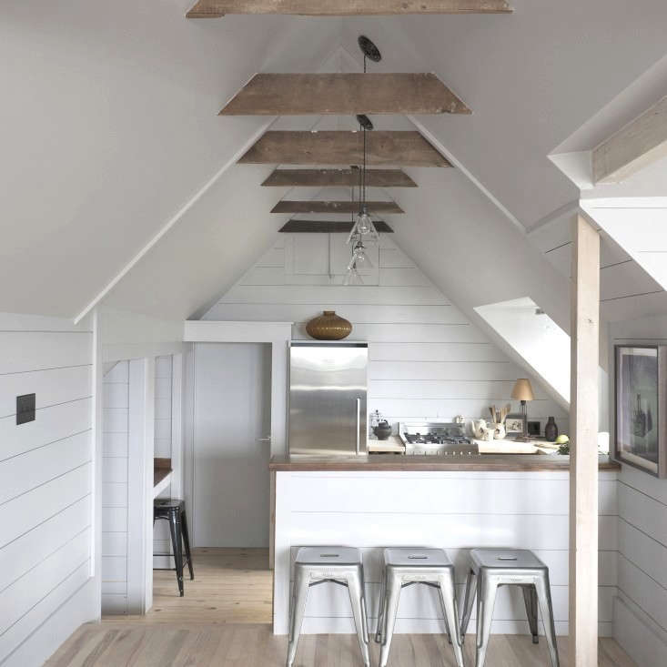 In the Old Homestead in Provincetown, designers Kristin Hein and Philip Cozzi of Hein & Cozzi built a small kitchen island that defines a kitchen area without breaking up the loftlike feel of the space. See more at Low-Key Luxury: The New Old Homestead in Provincetown.