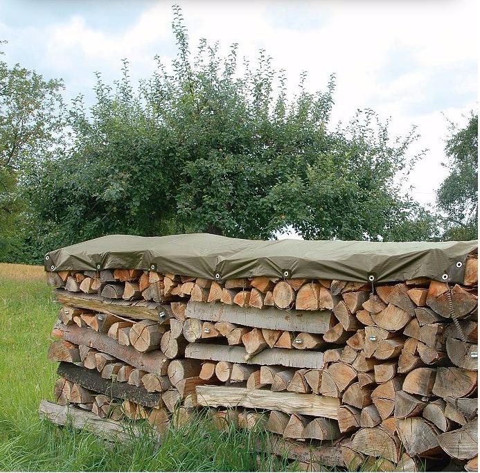 self stretching tarpaulin firewood log storage gardenista 1