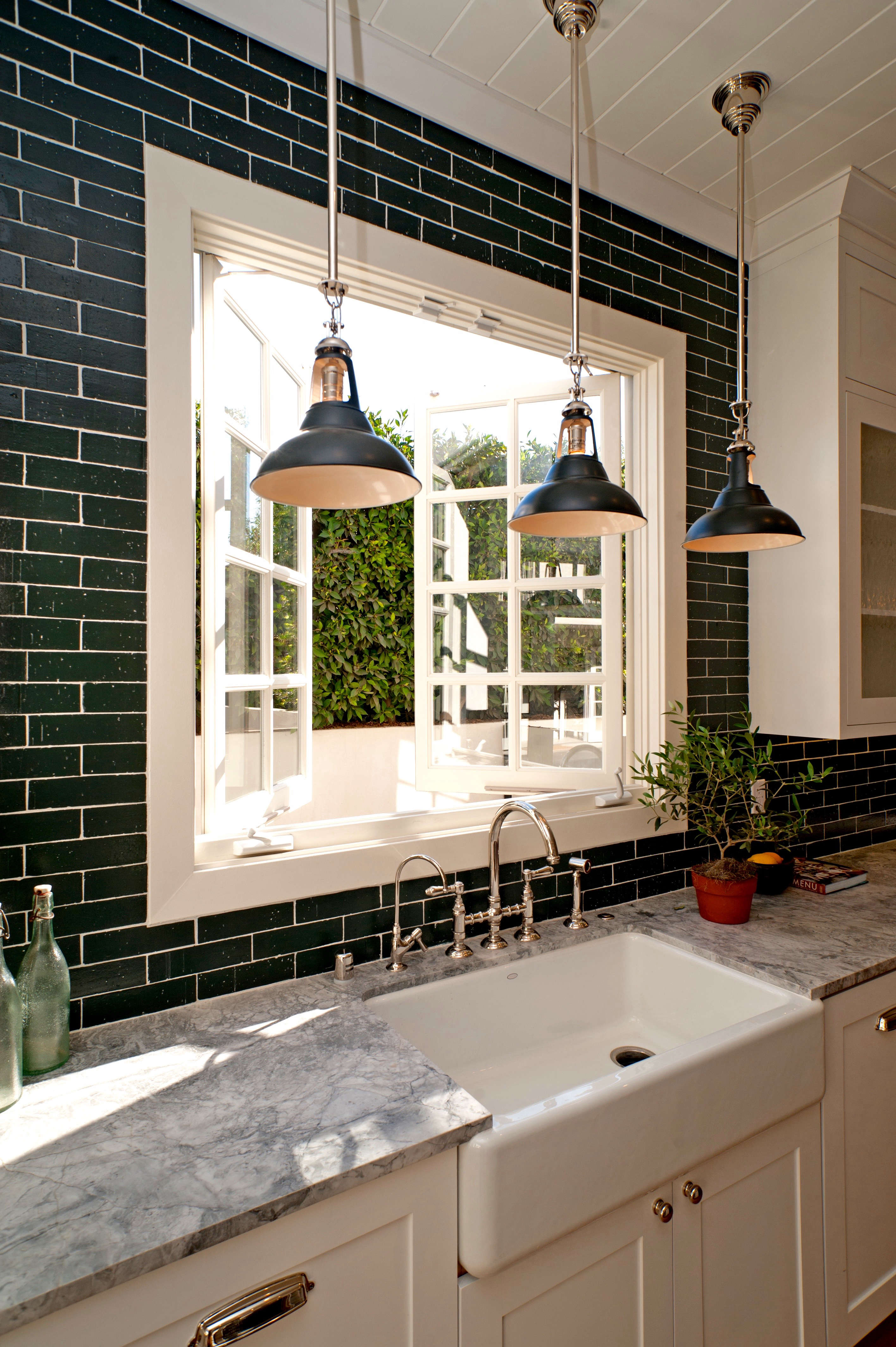 economical black painted brick veneer tiles in a kitchen by leigh herzig   remo 11