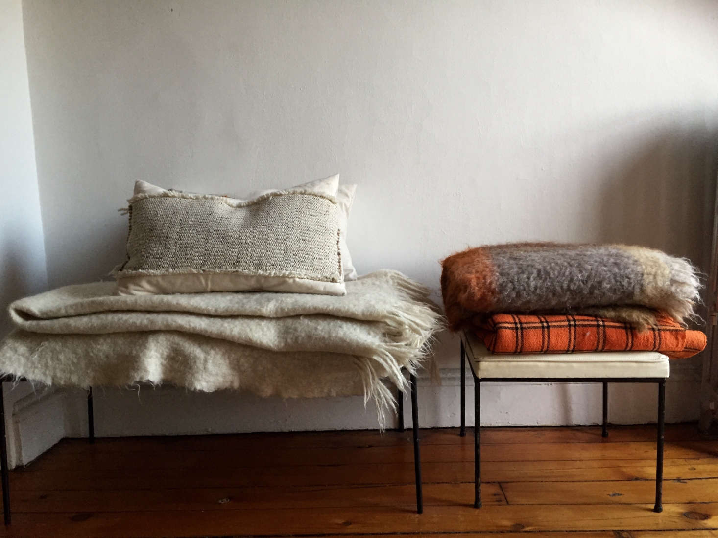 Stools stacked with hardy wool throws; photograph by Corinne Gilbert from Expert Advice: How to Decorate Like a Frenchwoman.