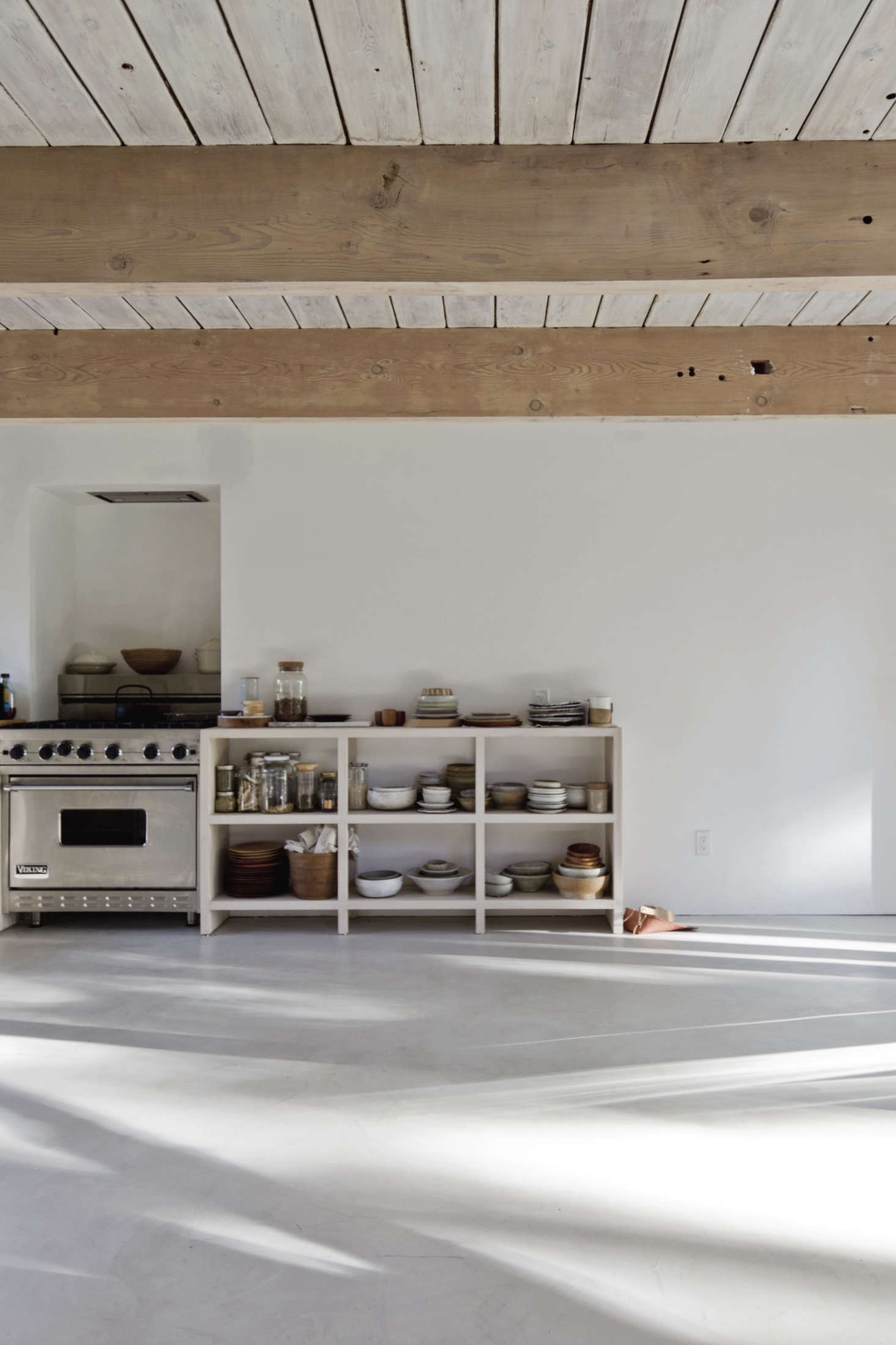 The kitchen ends in a pantry unit of rotary-cut Douglas fir plywood that&#8