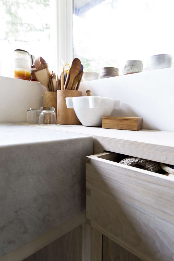 The drawers and cabinets have invisible touch-latchhardware. The Marble Mortar and Pestle is available from Williams-Sonoma.