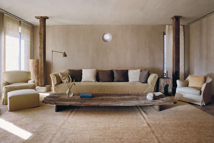 a raw wood slab makes a coffee table at thetribeca penthouse, designed by axe 10