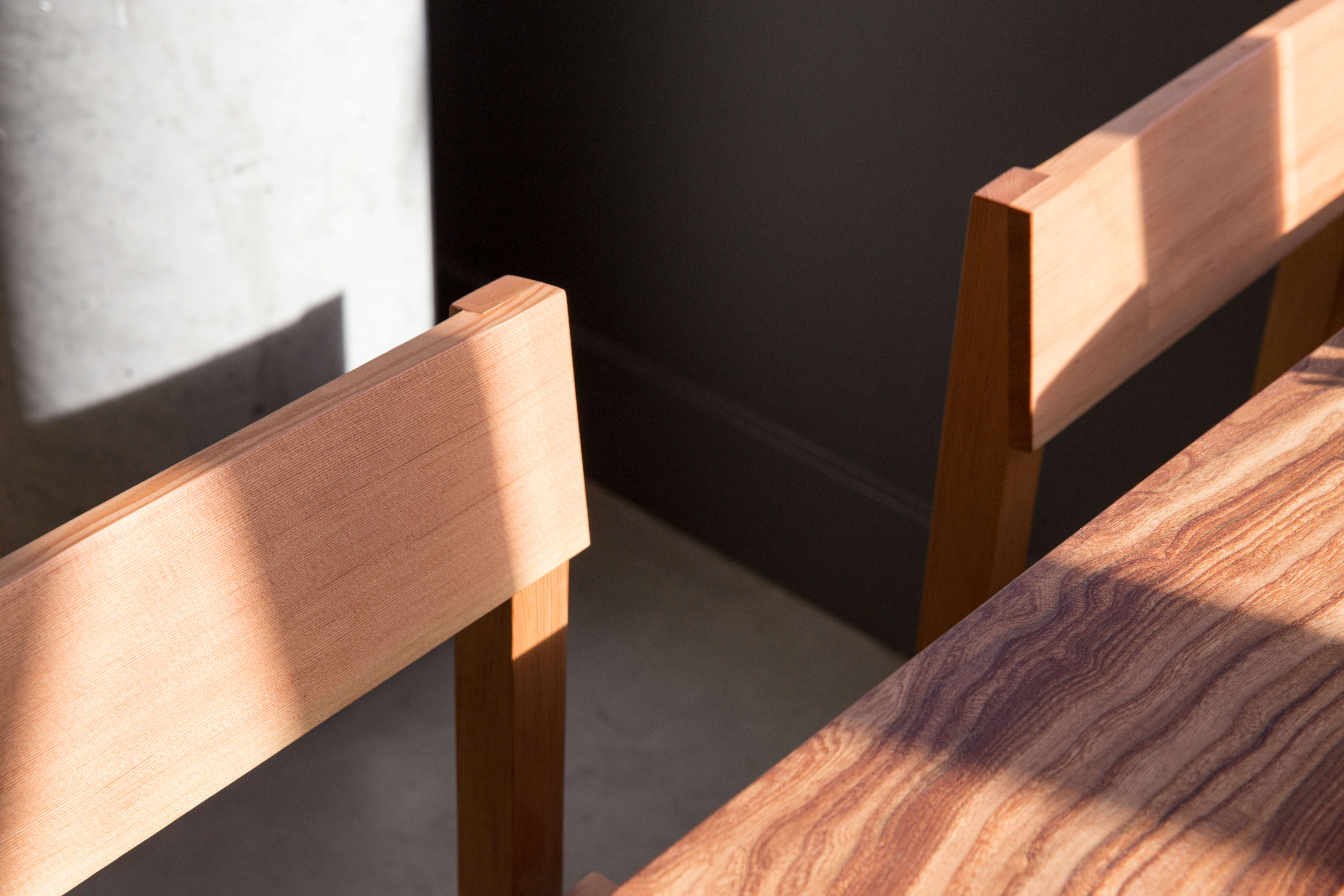 """A detail of the chair backs in vertical grain Douglas fir. """"Through a long prototyping process we made incremental changes to the angle and height of the chair until we found exactly what we wanted,"""" says Traverso."""