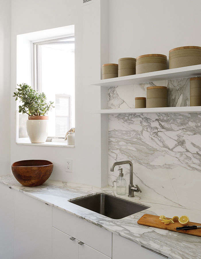 Caulk needs care in the kitchen too. Here a bead of caulk runs the seam between two marble slabs in Steal This Look: A Small but Smart Kitchen in Brooklyn. Photograph by Matthew Williams for Dwell Magazine.