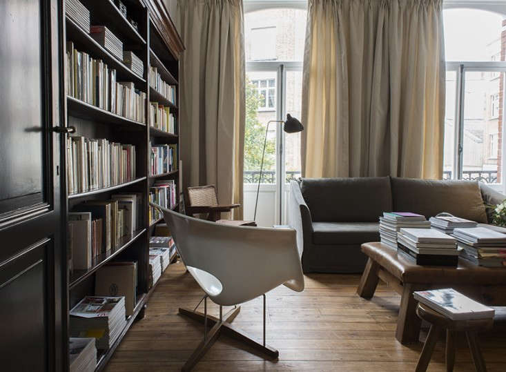a vintage leather gym bench in the living room of architectnicolas schuybroek. 13
