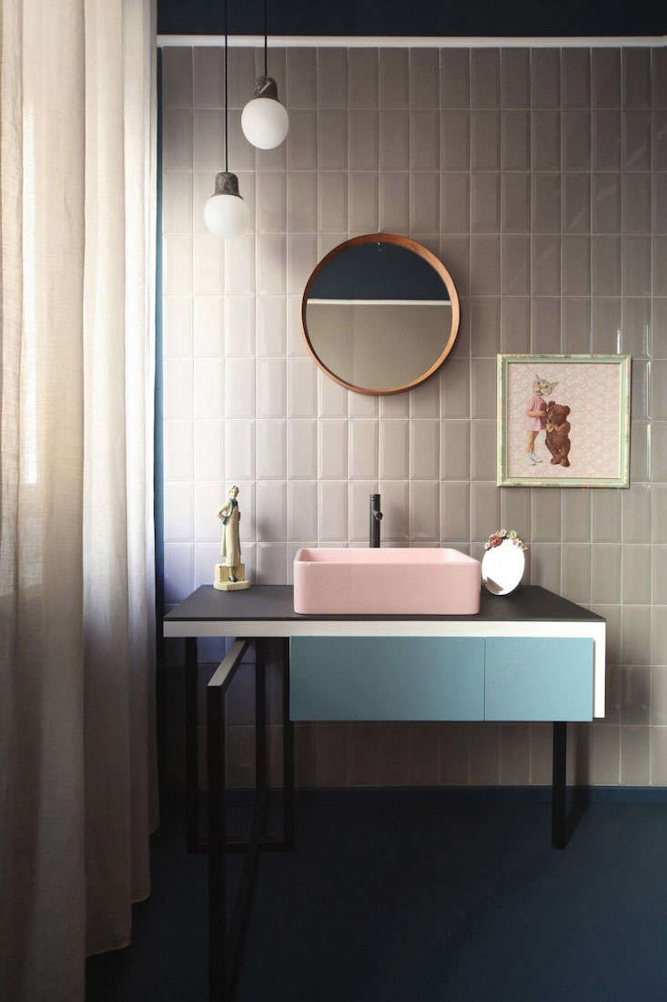 A modern vanity sports unexpected pastels in a bath designed by UdA Architetti in Milan.