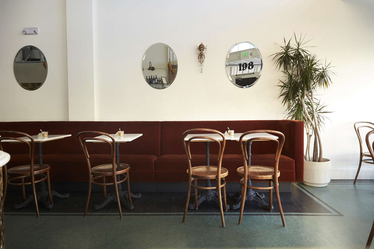 Deep green linoleum looks chic, not tacky, at Twentieth Century Cafe: Old Vienna Comes to San Francisco. Photograph by Laurie Frankel.