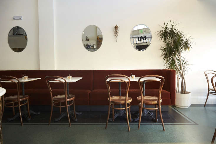 Deep green linoleum looks chic, not tacky, atTwentieth Century Cafe: Old Vienna Comes to San Francisco. Photograph byLaurie Frankel.