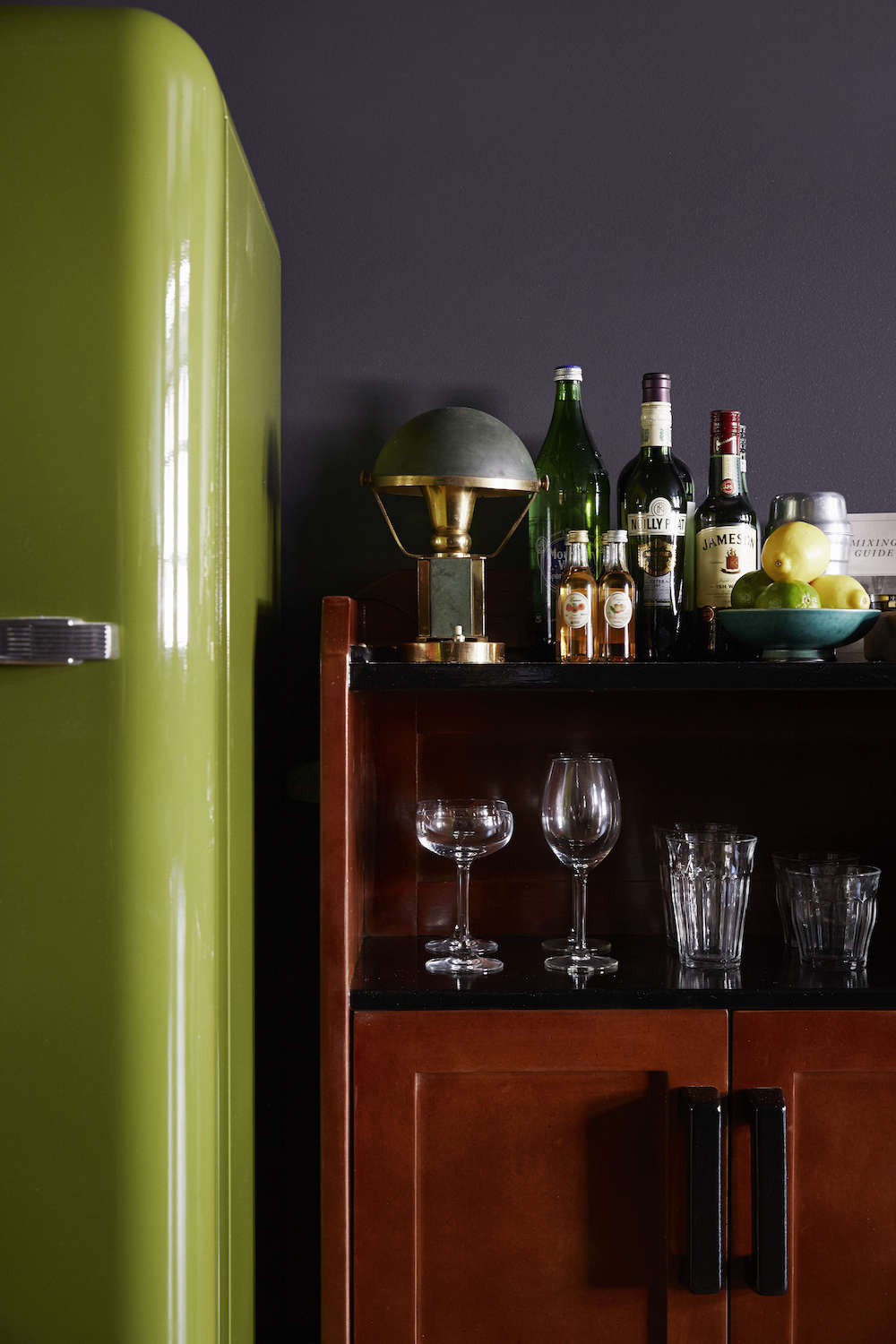 The Smeg refrigerator in a custom green color is stocked with fresh cocktail essentials.