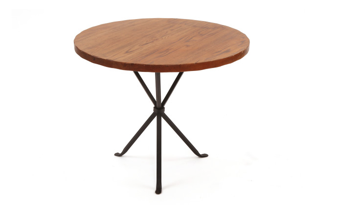 This Cleo BaldonIron and Oak Occasional Tablefrom the late fifties— inches tall and 30 inches in diameter—sold via Red Modern Furniture of Phoenix. Find more of the designer&#8