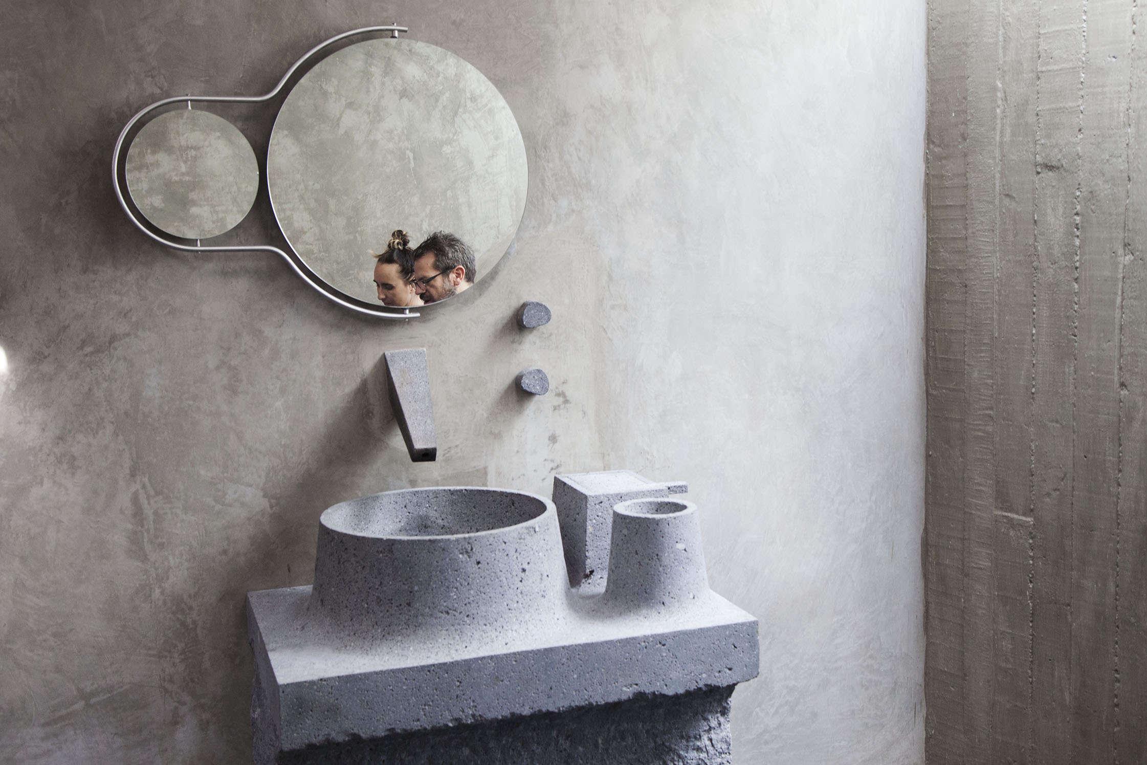 Caste concrete bathroom sink in Pedro Reyes and Carla Fernandez's Brutalist house in Mexico City via FvF | Remodelista