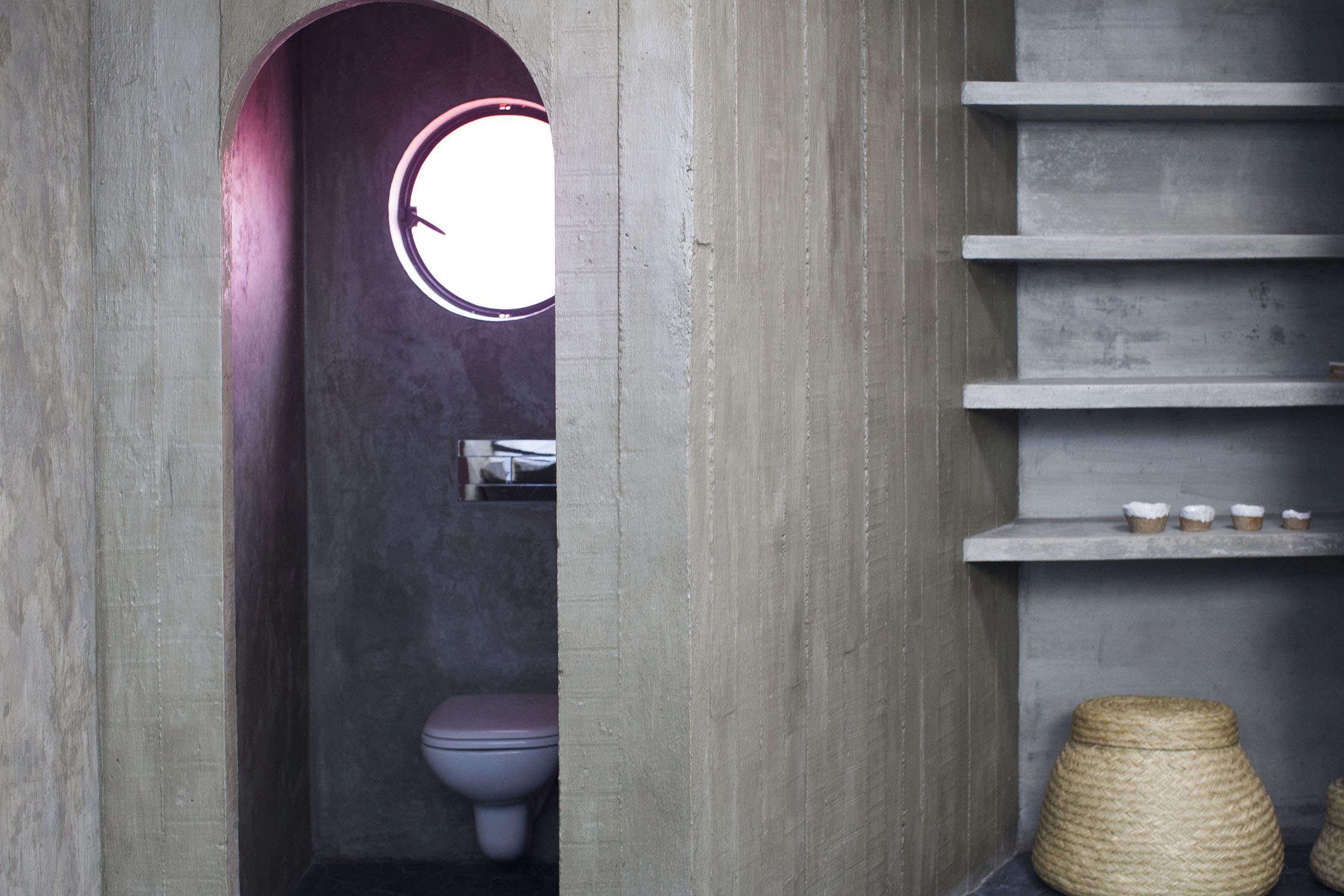 Concrete bathroom in Pedro Reyes and Carla Fernandez's Brutalist house in Mexico City via FvF | Remodelista