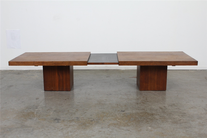 ThisJohn Keal Expanding Coffee Table is made of walnut and black laminate. It&#8