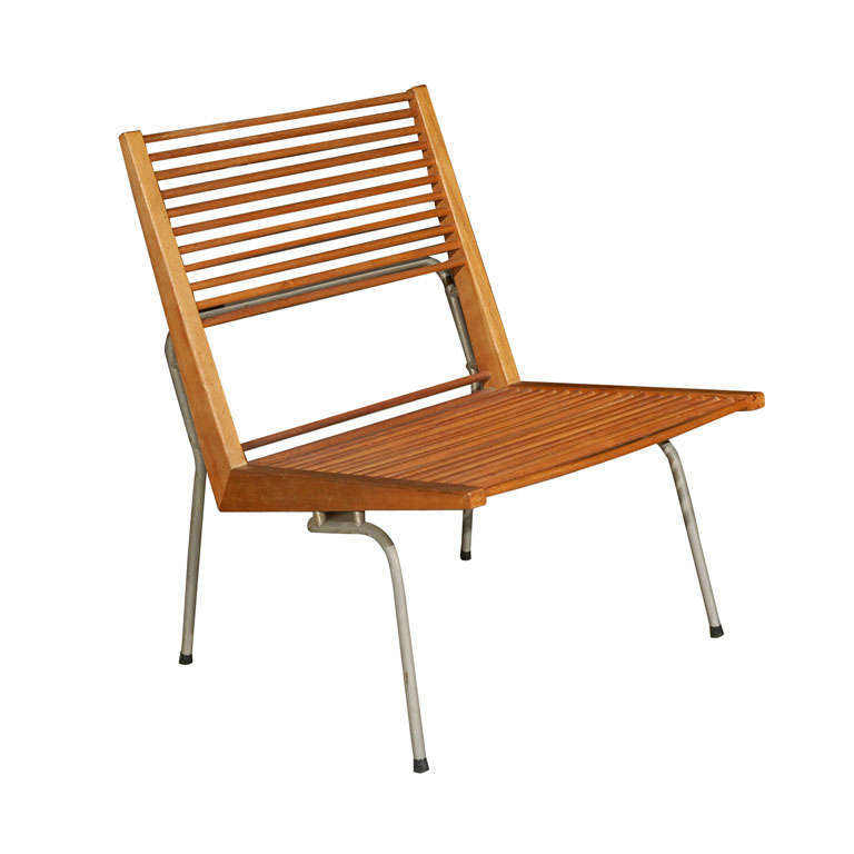 Martiné offered his lounge chair with wood dowels or rope cords on the seat and back.This examplesold for an unknown amount on loading=