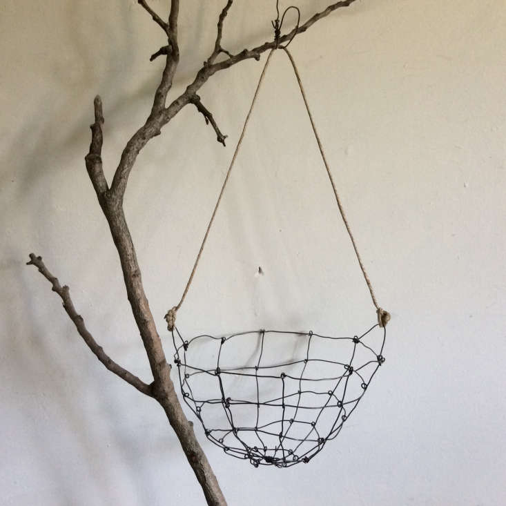 The New Rusticity 11 DIY Ways to Use Branches Indoors A branch as a stand in rack for (light) essentials; seeVagabond Chic: Instagram Stars Mr. and Mrs. Charlie Launch a Shop.