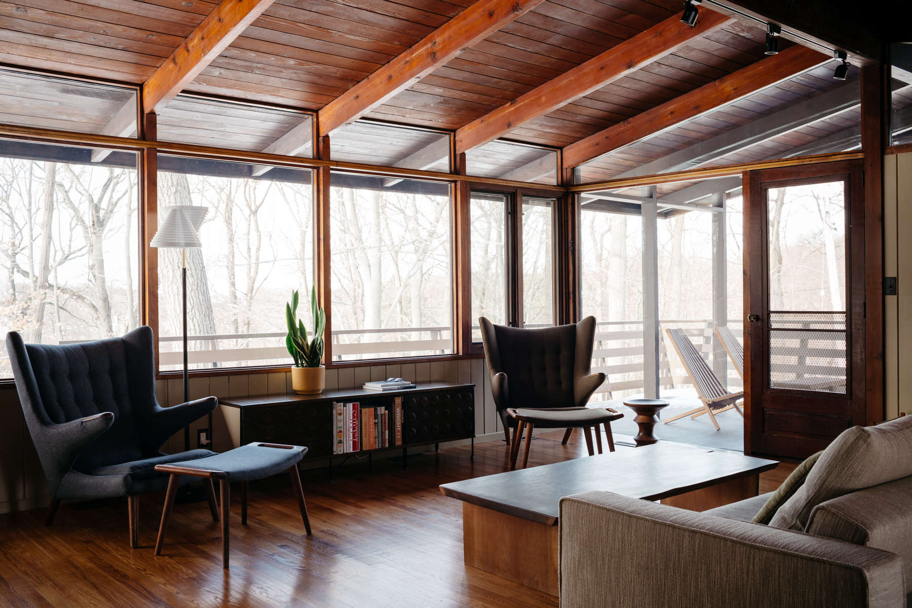 The living room at the Wood House, Carla and Niall Maher's midcentury ranch, an ongoing remodel/restoration project in Westchester, NY, photographed by Brian W. Ferry for Remodelista