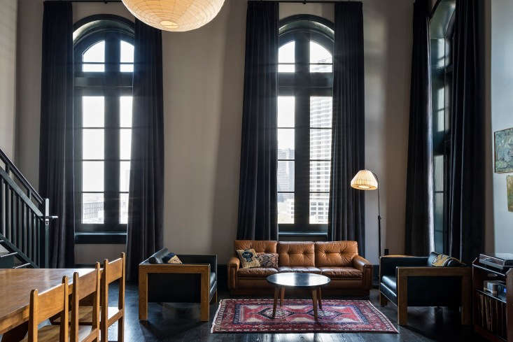 the grand ace suite, with two floors and soaring windows. 18