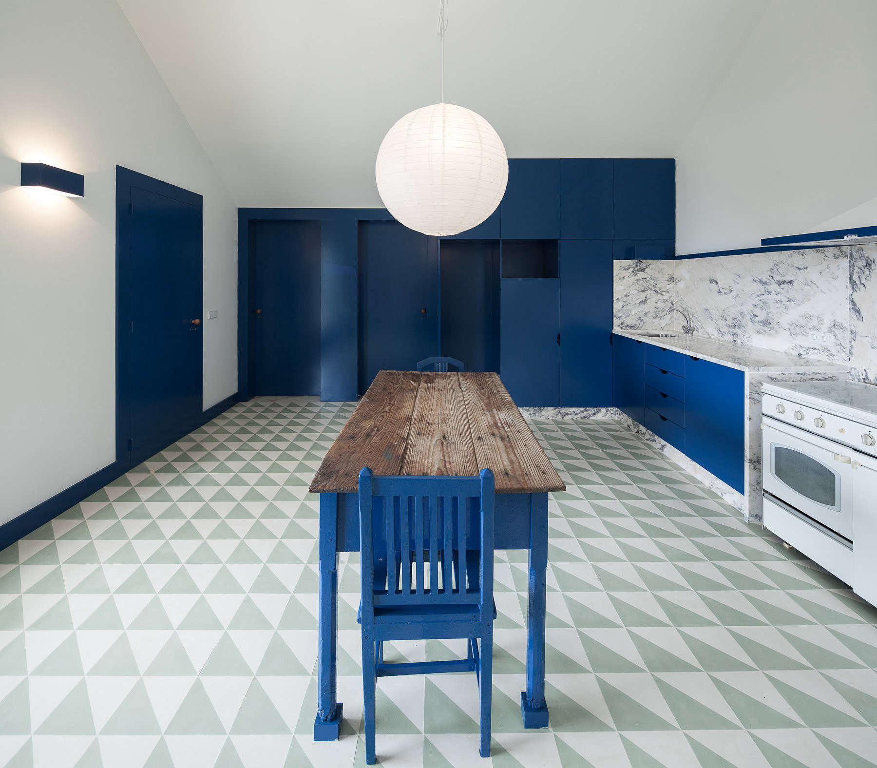 geometric ceramic tiles on the kitchen floor are a nod to traditional portugues 9