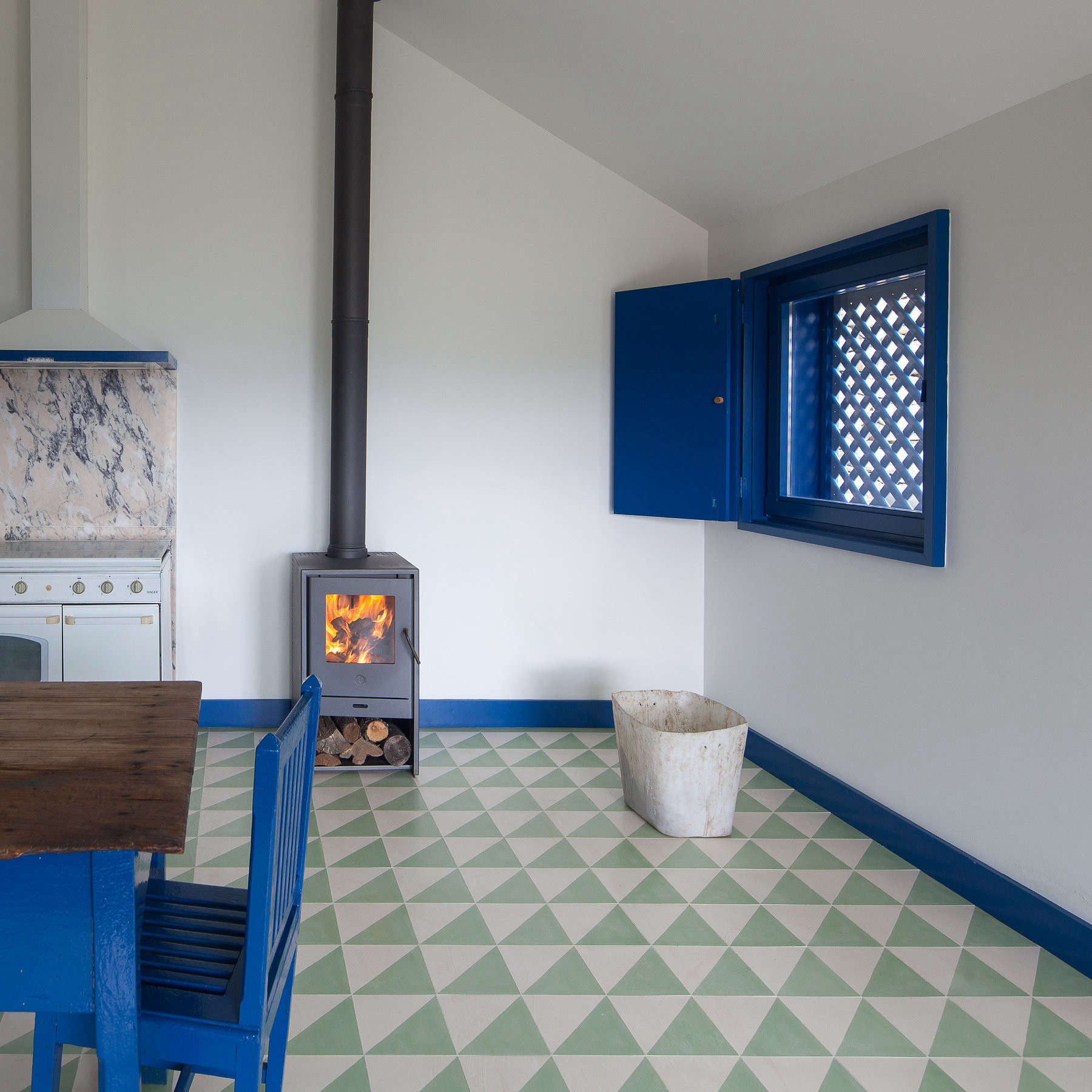 a freestanding wood stove is the heat source in the evenings and colder months. 10