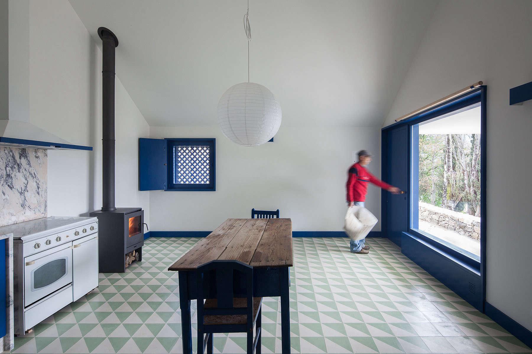 cabinets, windows, doors, and trim are all painteda vibrantblue. 11