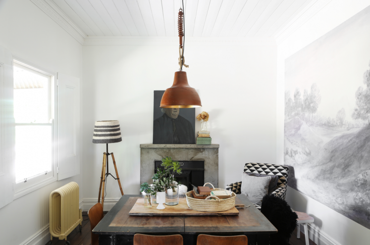 At The Estate Trentham interiors stylist Lyn Gardener ofGardener &Marksused a simple pendant and a paneled ceiling to help emphasize the height of this intimate dining room.