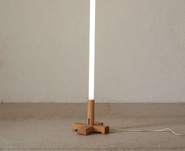 neon tube light wood stand urbanoutfitters remodelista 13