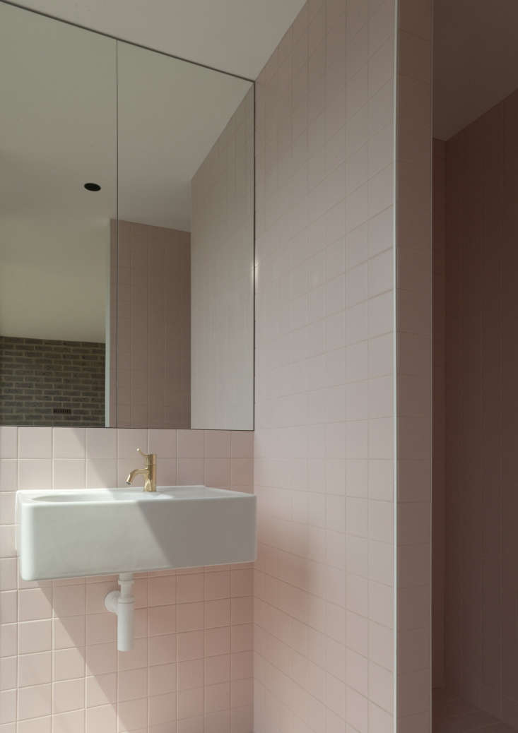 a modern take on a retro trend in this bath, tiled floor to ceiling in subtle p 12