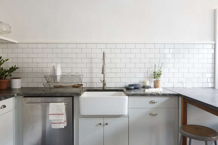 Another place where regular cleaning can help prevent dirty grout: the kitchen backsplash. See Philadelphia Story: Two Creatives Tackle Their Own Kitchen; photograph by Michael Persico.