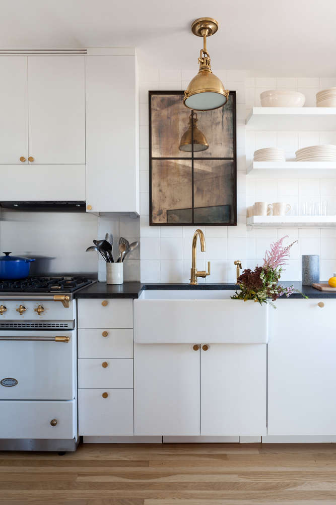 An under-cabinet range hood inKitchen of the Week: A Small Kitchen with Big Personality for Comedian Seth Meyers.