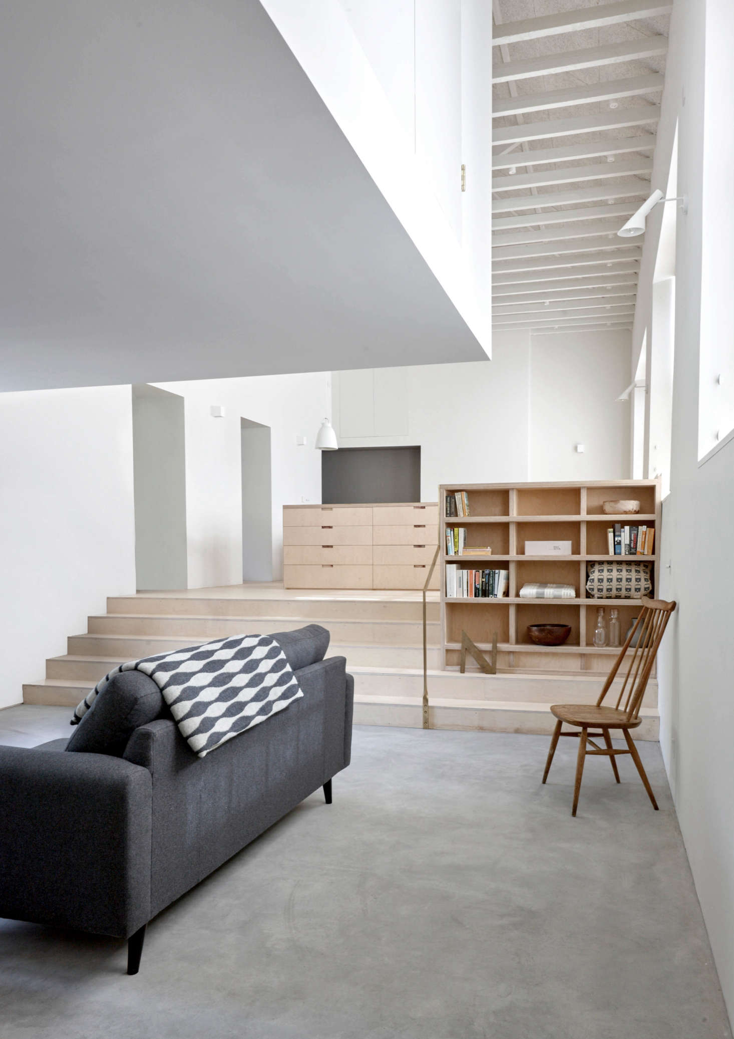 The living area fits tidily beneath the bedroom without feeling hemmed in. Here&#8