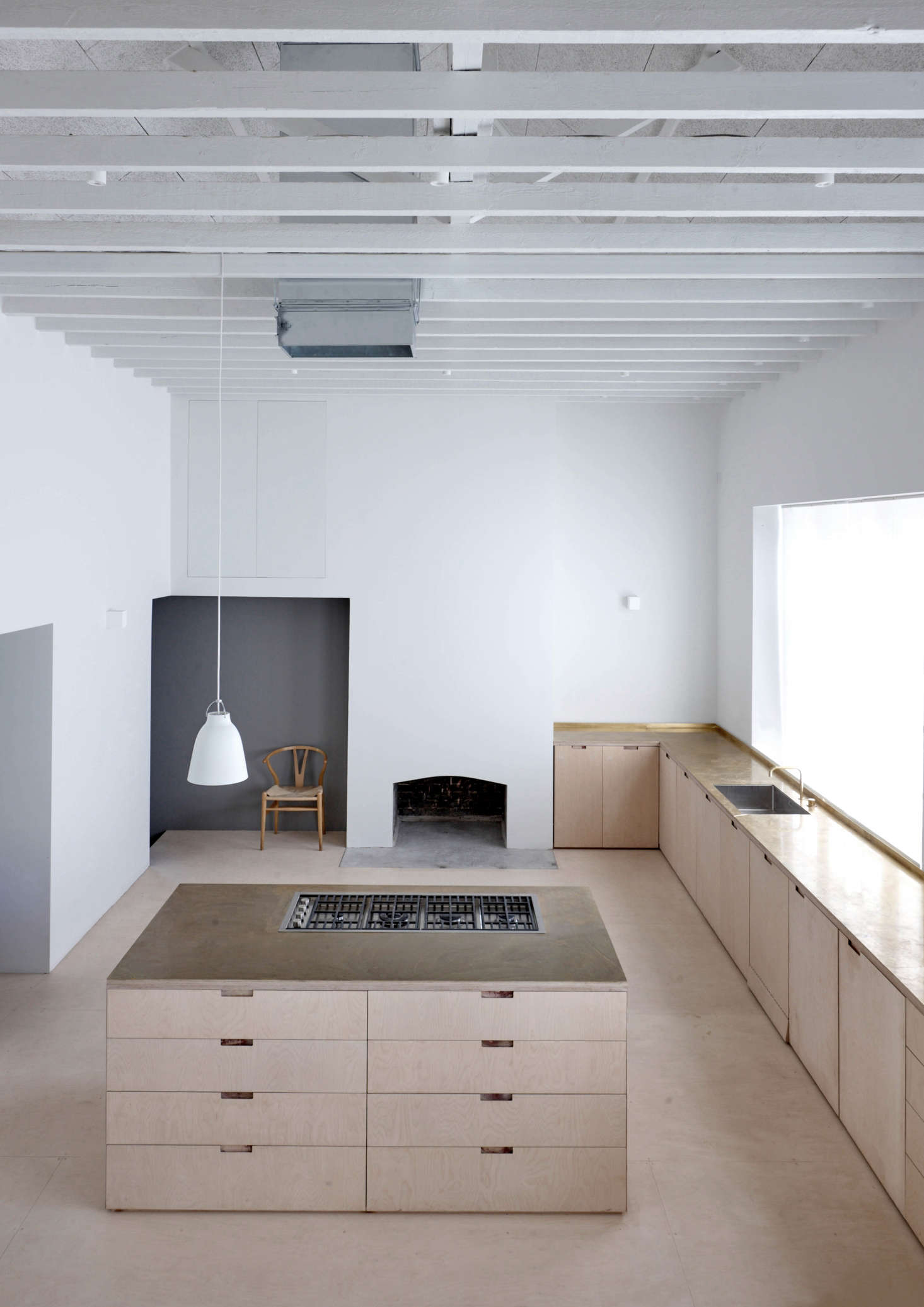 Viewed from the upstairs bedroom, the kitchen is &#8