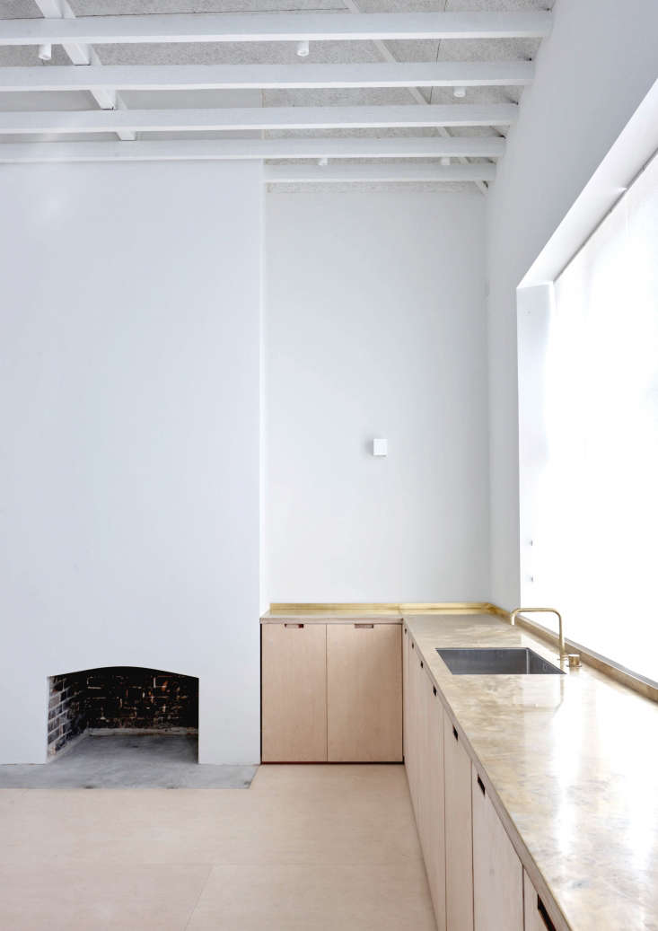 Lessons in Reinvention A Victorian Girls School Reborn Brass countertops and a Vola faucet addan element of luxuryto the space. The original hearth was preserved in a newguise.