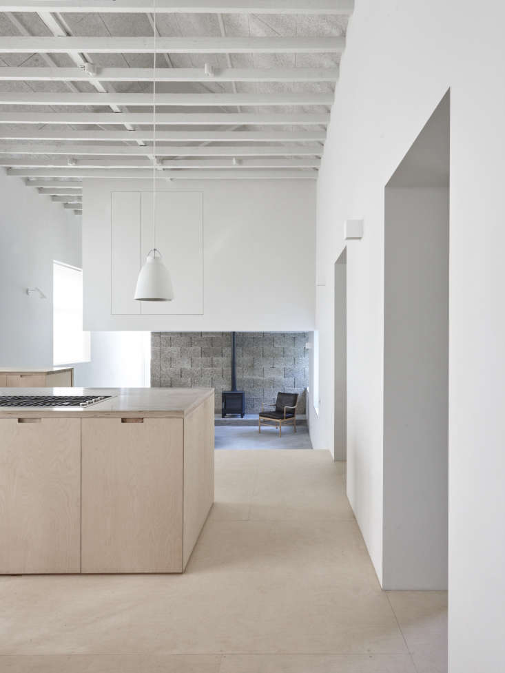 Lessons in Reinvention A Victorian Girls School Reborn The ground floor featuresa dramatic double height kitchen. It opens to the living room and clubhouse like new second story bedroom area that the architects carved out of gained and unused space—read on for trade secrets.