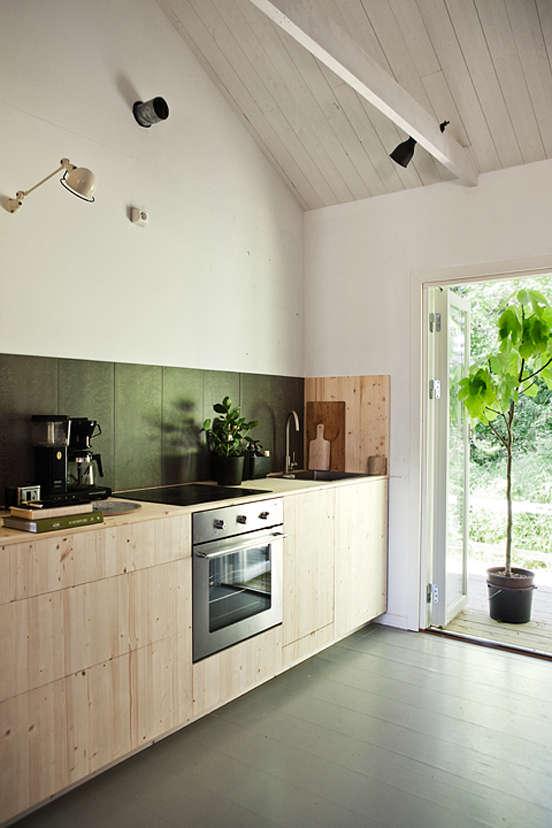 nordic designed kitchen at sagverket, a retreat center and hostel in northern s 13