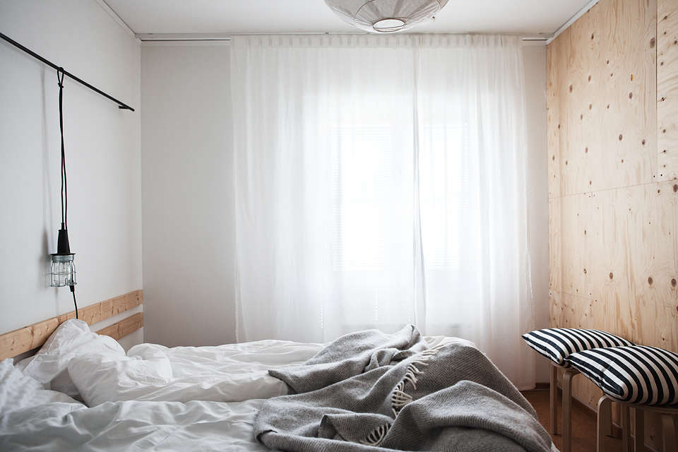 scandi design in a guest room at sågverket, a stylish country hostel and retr 15