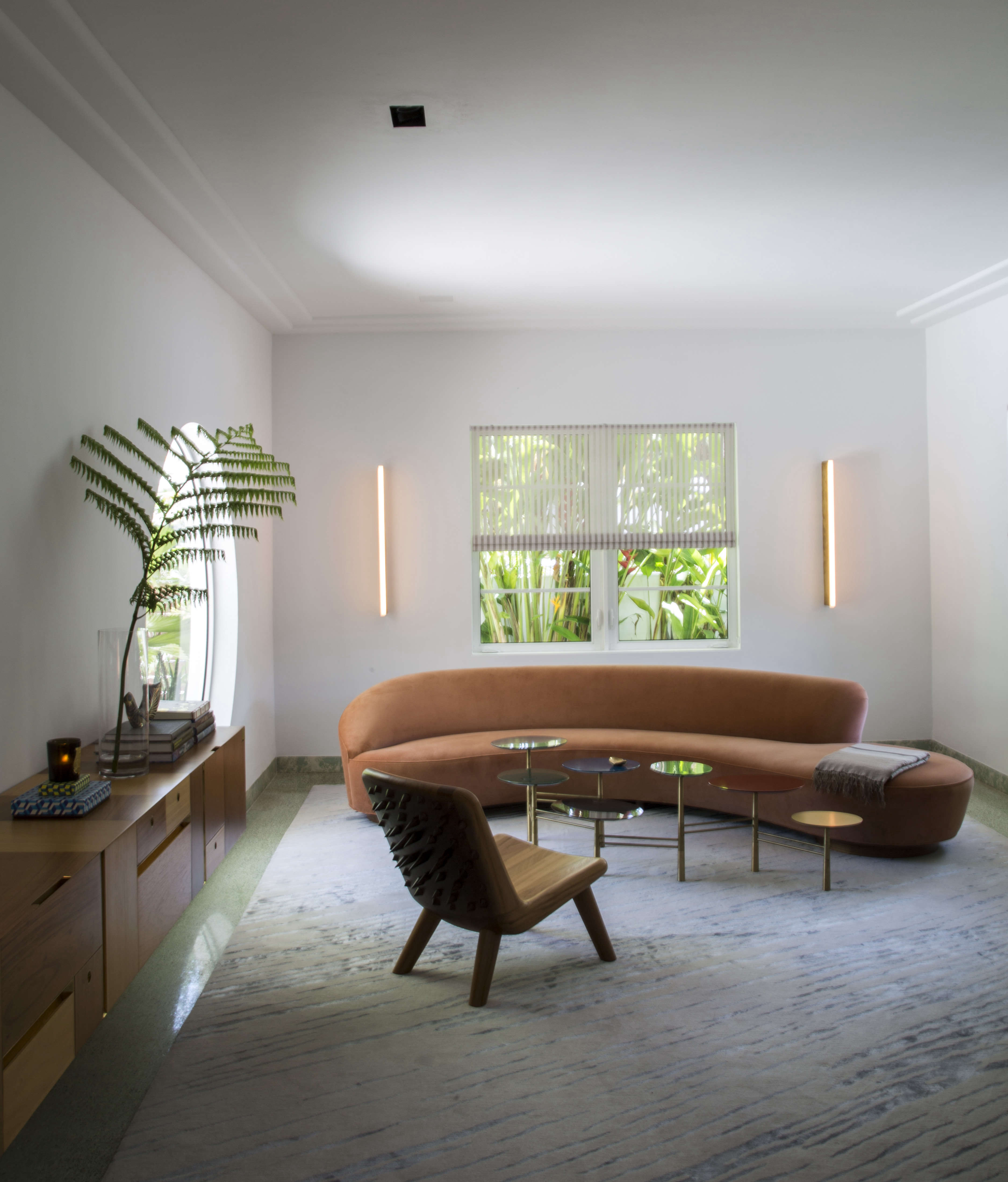 Modern in Miami At Home with a Worldly Contemporary Furniture Dealer Living room with Vladimir Kagan sofa in Miami art deco villa remodel by Stephan Weishaupt, owner of Avenue Road, Max Zambelli photo | Remodelista