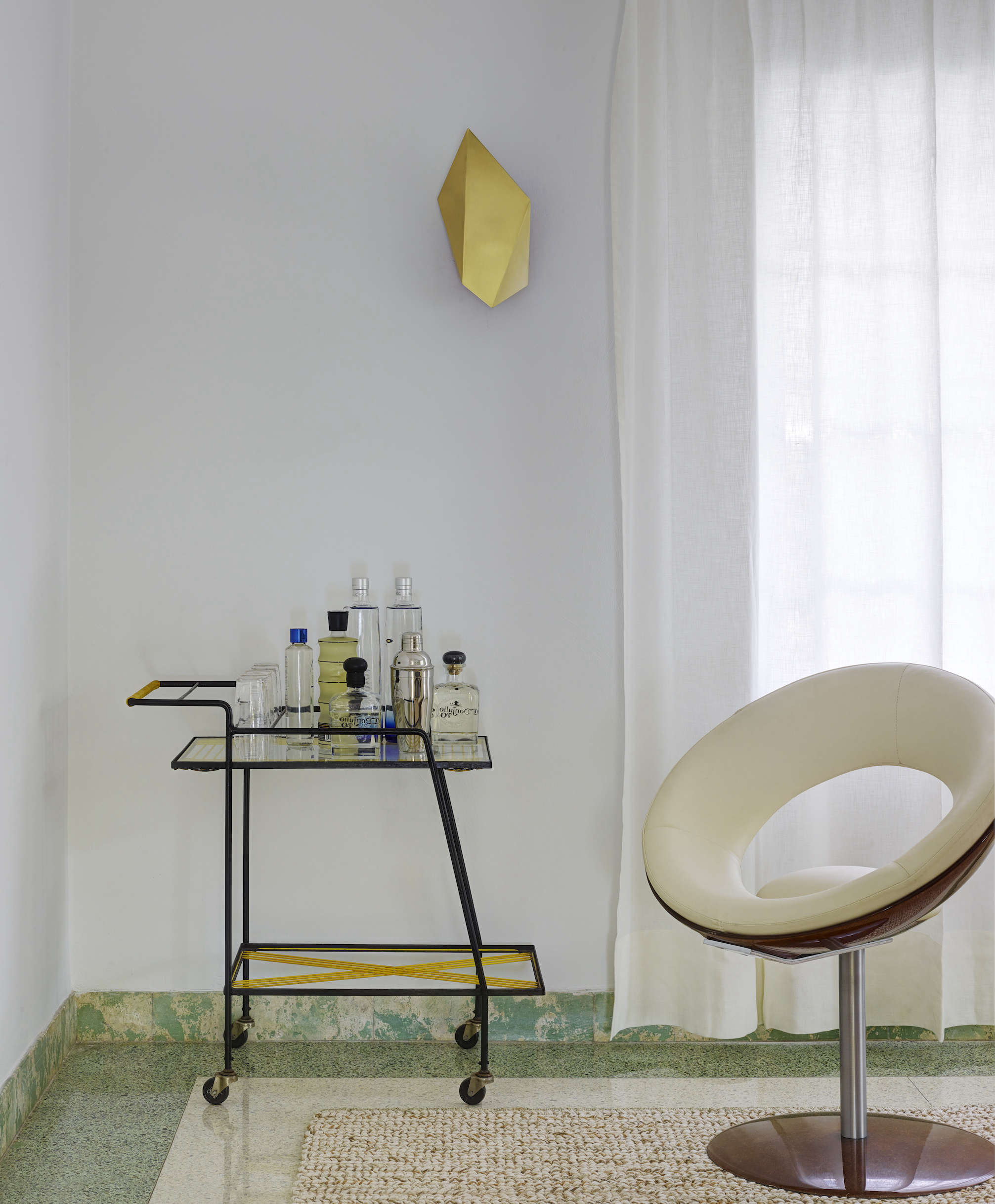 Modern in Miami At Home with a Worldly Contemporary Furniture Dealer Bar cart in a revived 1932 Miami villa belonging to contemporary furniture dealer Stephan Weishaupt of Avenue Road, Richard Powers photo | Remodelista