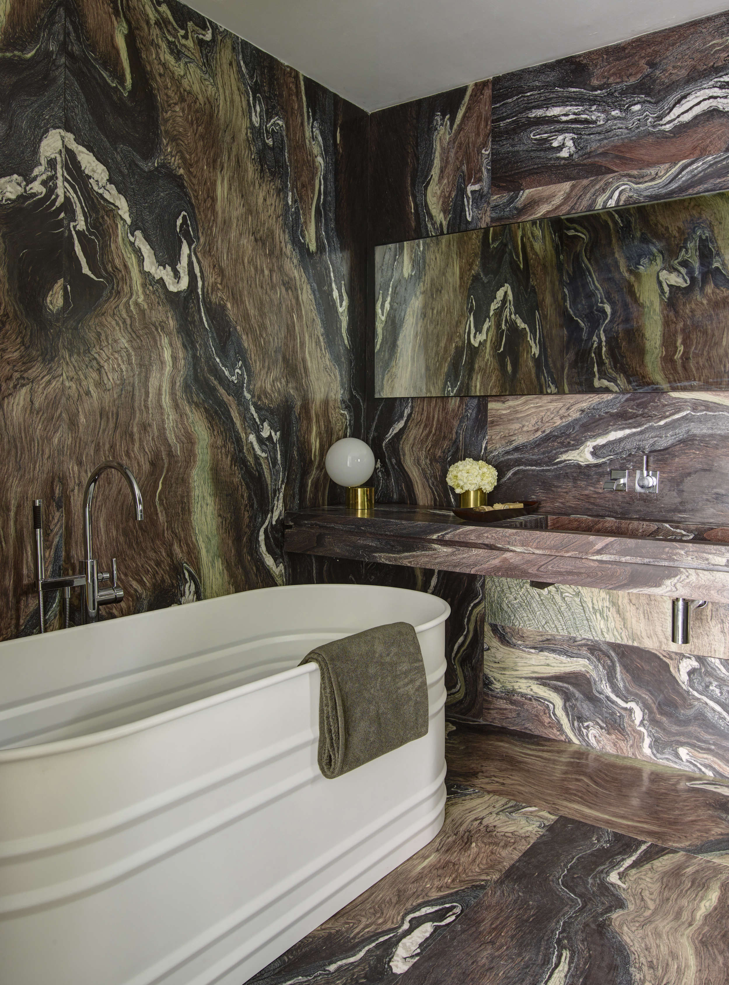 Modern in Miami At Home with a Worldly Contemporary Furniture Dealer Dramatic brown marble bath in a revived 1932 Miami villa belonging to contemporary furniture dealer Stephan Weishaupt of Avenue Road, Richard Powers photo | Remodelista