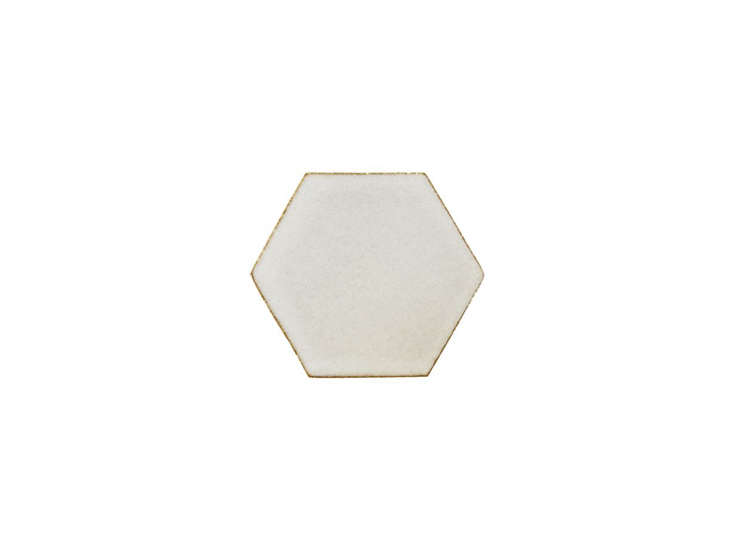 The Stoneware Elements Field Tile in a hexagon shape is available in a few different blue and green hues, similar to the floor tiles in theSão Paulo kitchen. Available through Ann Sacks.